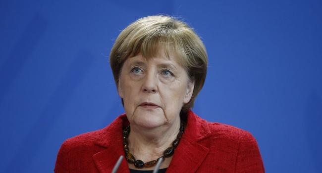 Меркель не исключила возможность поездки в Россию на ЧМ-2018