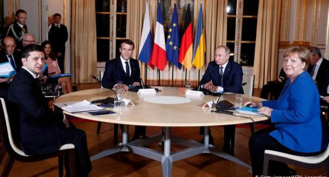 Политолог: команда Зеленского пытается выполнить Минские соглашения любой ценой